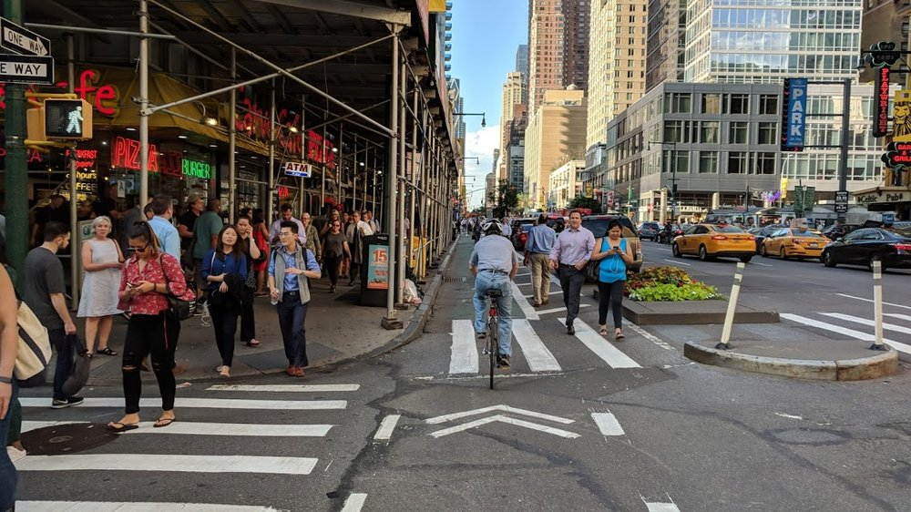Try to cycle on the sidewalk here and you would bump into everyone. For how wide the avenues of Manhattan are, very little space is allocated to people; they are even overflowing into the bike lane!